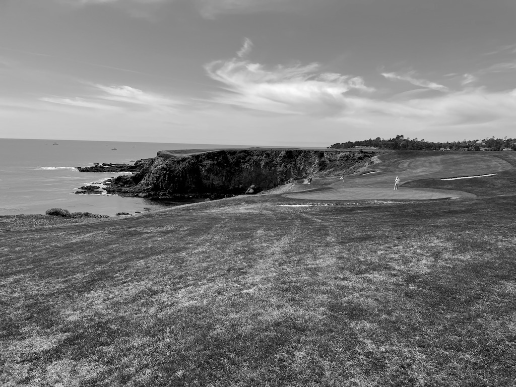 Looking back on hole 8. This is often referred to as the best second shot in golf. Your first shot (ideally) lands at the edge of the cliff way off in the distance. Then you hit your second shot across the ocean and (ideally) onto the green.