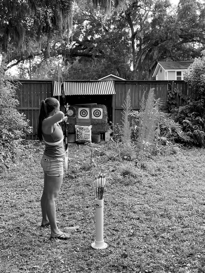 Here's Shelby getting her archery lesson from her dad. We stood much closer to the target.